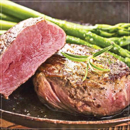 Center Cut Rib-Eye Steaks with Brandy Peppercorn Sauce, Potato Rösti, and Roasted Asparagus