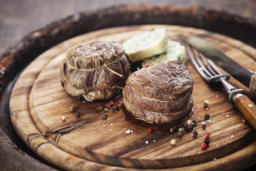 Beef steak filet mignon and butter with herbs