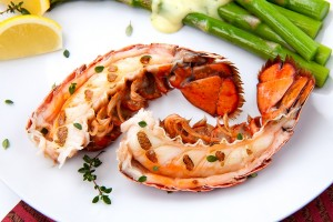 broiled lobster tail, lightly brushed with herbed butter