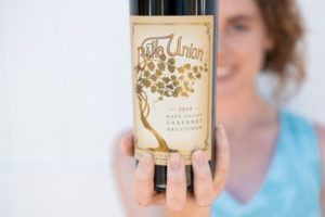woman holding Bella Union Cabernet Napa Valley