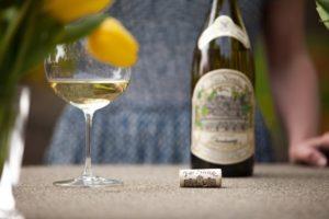 Woman drinking Far Niente Chardonnay